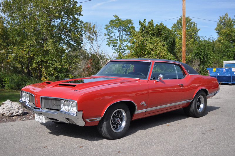 1970's Projects  1970 Oldsmobile Cutlass SX red car with black top