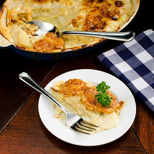 Celery Root and Potato Gratin on plate, with baking dish in background