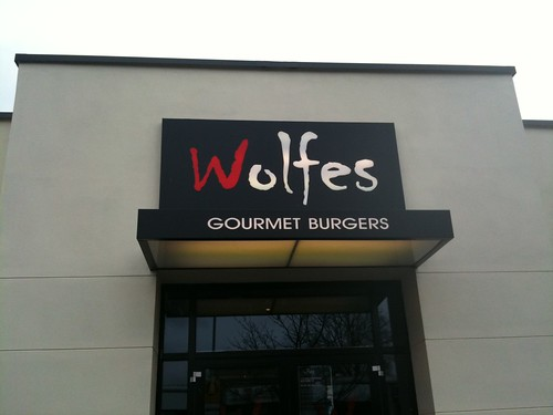 WOLFES ILLUMINATED DIBOND & PERSPEX SIGN & CANOPY