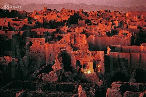 city houses homes light sunset orange house afghanistan man building men home yellow horizontal standing buildings landscape outside outdoors fire evening amber town stand aftermath warm sitting glow cityscape exterior village sundown adult dusk campfire flame sit 1992 townscape adults desolate seated destroyed bombing bombed ruined herat 484999 afghn10124