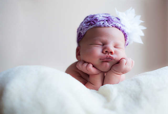 Experimenting with newborn baby portraits that incorporate cute hats its not as easy as it