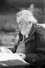 Portrait of an unknown newspaper reader