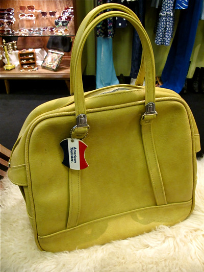 Ladies and Gentlemen, you have seen the ads all over town! Yes, American Tourister has arrived on our shores..  Be the envy of your friends by owning this FABULOUS vintage 1960s American Tourister bag instead. Lovely mustard, with original luggage tag attached!  A definite MUST-HAVE!!!