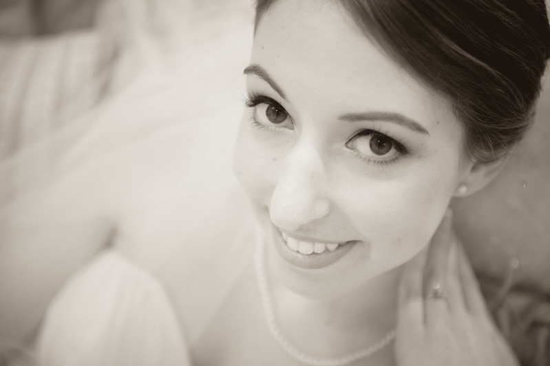 Wide eyed smiling bride