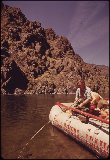 DOCUMERICA: MEMBERS OF SNAKE RIVER RAFT TRIP CATCH SMALLMOUTH BASS IN HELLS CANYON, 05/1973 Boyd Norton