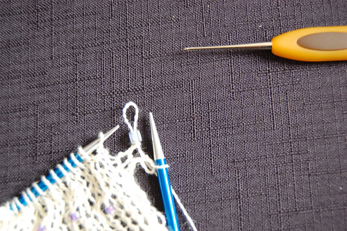 Place bead onto knit stitch and return stitch to RHN