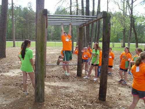 4-H campers enjoy incorporating fitness into a healthy lifestyle.  Here, participants work to complete an obstacle course.