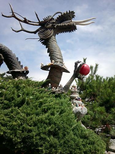 Dragon statue & votive offerings