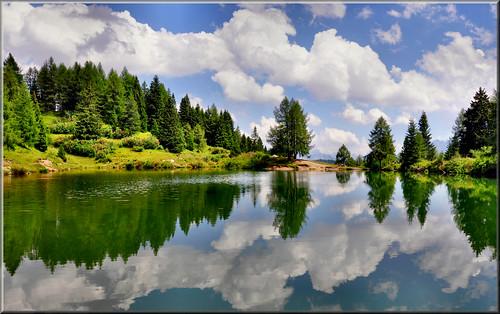 Dolomiti - riflessi in un laghetto  vicino  al Passo San Pellegrino by Luigi Alesi