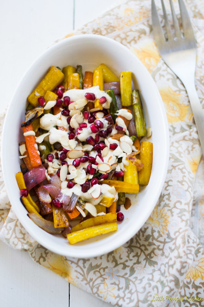 Colorful vegetables are tossed with tangy pomegranate molasses and honey before being roasted and caramelized. Then finished with a good drizzle of creamy tahini sauce ,pomegranate seeds and almonds.