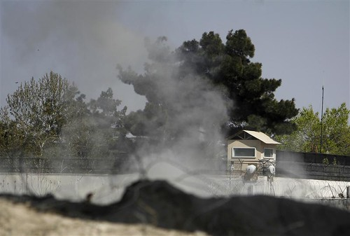 Smoke rises from a tower belonging to the British embassy after gunmen launched multiple attacks in Kabul April 15, 2012. The Taliban has launched a spring offensive with ferocity and boldness against the US-NATO occupationist forces. by Pan-African News Wire File Photos