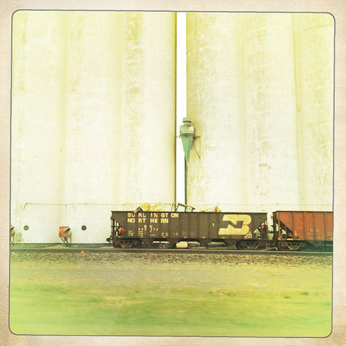 Burlington Northern Train Cars Dwarfed by Kansas Grain Elevators