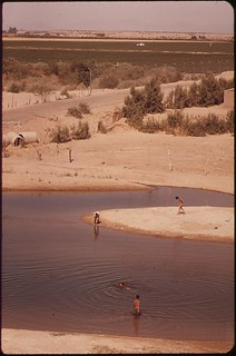 The Colorado River shrinks to a trickle at the Mexican border. These swimmers and bathers are on the Mexican side, May 1972
