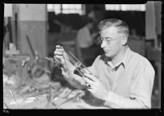 Glass bottles. L. G. Nestor Co. Tube worker blowing conductivity cell, March 1937