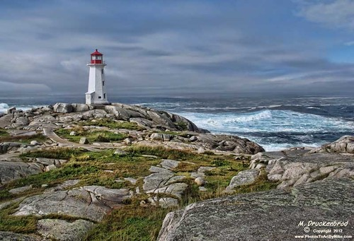 Set on rocky shores, the Lighthouse at Peggy's Cove