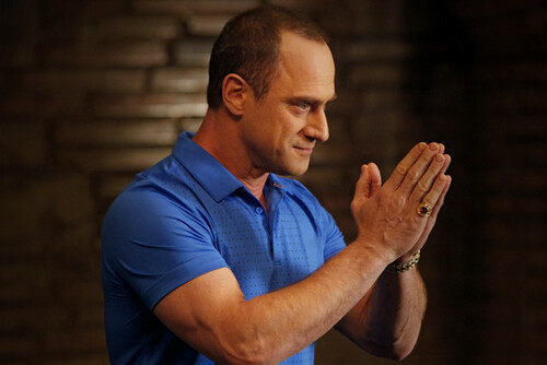 Christopher Meloni wearing a blue polo shirt