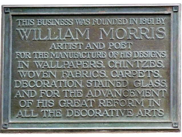 William Morris bronze plaque - This business was founded in 1861 by  William Morris  Artist and Poet  for the manufacture of his designs  in wallpapers, chintzes,  woven fabrics, carpets,  decoration, stained glass,  and for the advancement  of his great reform in  all the decorative arts