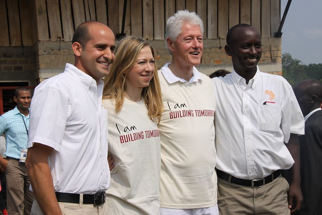 Building Tomorrow Founder & Uganda Country Director, George Srour and Joseph Kaliisa, with President & Chelsea Clinton at the Building Tomorrow Academy of Gita on Friday, July 20