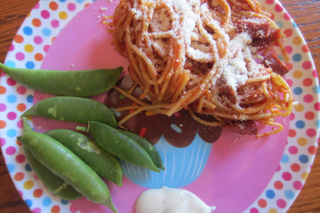 Addy eats: spaghetti, parmesan cheese, sugar snap peas, and a smidge of ranch dressing