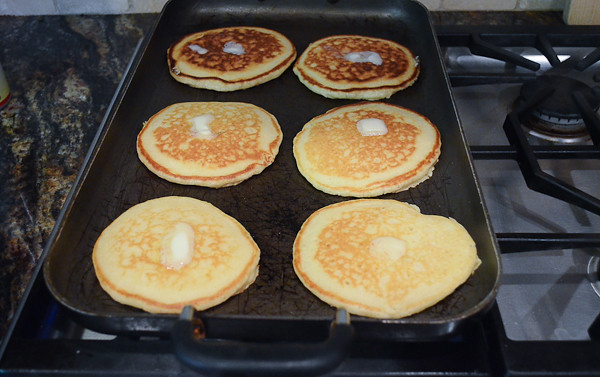 Butter added to the tops of the pancakes.
