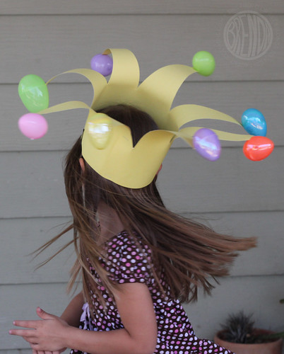floppy jester hat with Easter eggs on a child's head