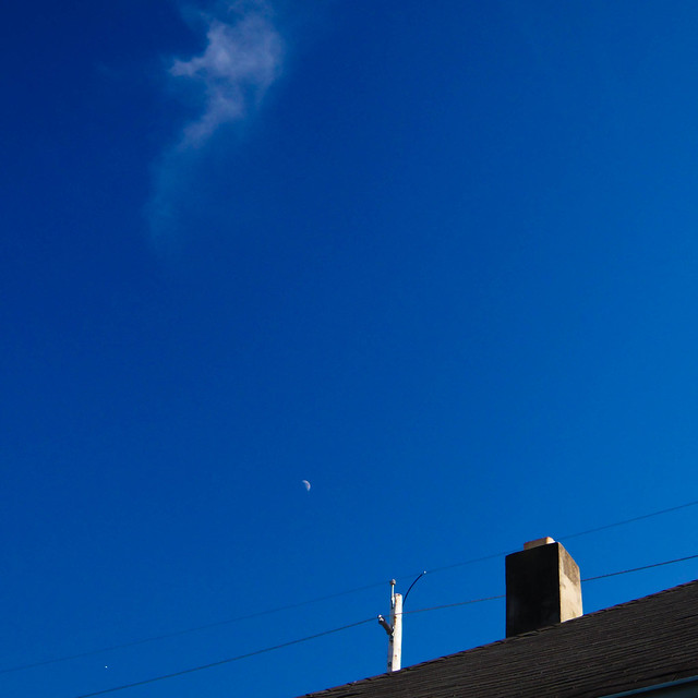 Roof, Chimney, Power Lines, Moon, and Some Clouds