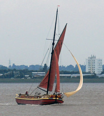 sailing ship(0.0), dinghy(0.0), ship(0.0), windjammer(0.0), watercraft rowing(0.0), longship(0.0), proa(0.0), galeas(0.0), tall ship(0.0), viking ships(0.0), sail(1.0), sailboat(1.0), sailing(1.0), vehicle(1.0), sailing(1.0), galway hooker(1.0), thames sailing barge(1.0), mast(1.0), lugger(1.0), watercraft(1.0), scow(1.0), dinghy sailing(1.0), boat(1.0),