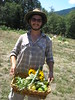 intern with basket of garden produce at Sanctuary One
