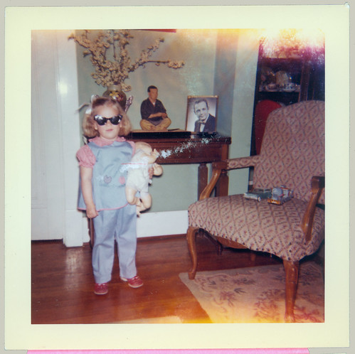 Child and doll and sunglasses