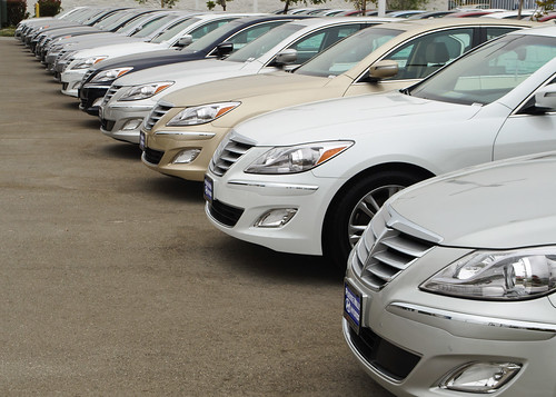 A line of cars in a dealership
