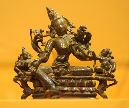 Arya Tara with two Bodhisattvas, on lotus flowers, holding flowers, touched so many times her face has worn down, bronze, jewels, right foot on a lotus bud, Art Institute of Chicago, Illinois, USA by Wonderlane
