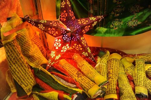 Light star, Tibetan Buddhist Prayer flags, wrapped up for sale, green silk formal khatag (kata), Mall, Anchorage, Alaska, USA by Wonderlane