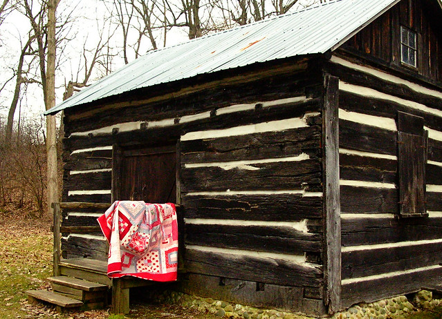 Red + Gray quilt on the porch