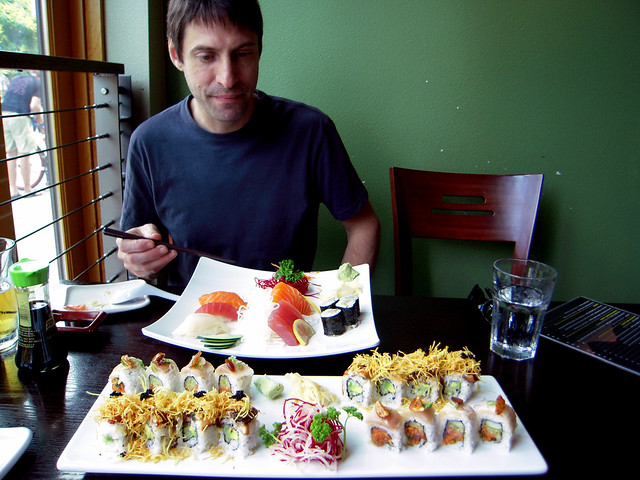 Mike eyeing his next piece of sushi