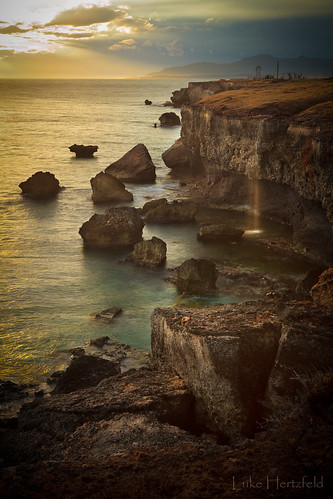 ocean light sunset sea seascape storm mountains nature rock landscape outdoors evening coast waterfall seaside surf ray dusk cliffs boulders guantanamobay caribbean geology gtmo