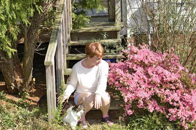 Elizabeth Ruffing with bright pink azaleas