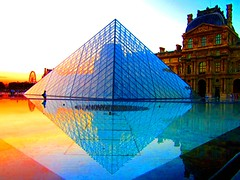 Go ahead and click the image for an even better view. .  From my archives.  Glass Pyramid . The most recent addition to the Louvre was the Louvre was the construction of the glass pyramid, which functions as the museum's main entrance. The pyramid was built in 1989 by the renowned American architect I.M. Pei. The glass pyramid allows the sunlight to come in on the underground floor.  The modern addition originally received mixed reviews, as it contrasts sharply with the classical design of the surrounding buildings, but today it is generally accepted as a clever solution which has given the museum a spacious central entrance without the need to touch the historic patrimony.  www.aviewoncities.com/paris/louvre.htm  Have a great new week! Love it that you stopped by!