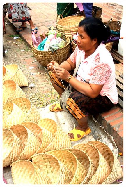 luang prabang morning market basket vendor