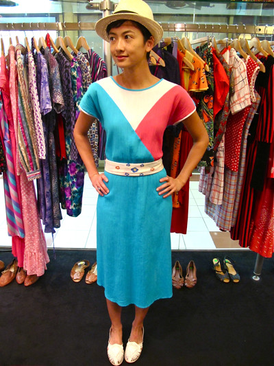 Go Angle-manic with this bold 1980s tri-coloured dress, worn belted with a hand-painted silk scarf. Size S/M.
