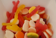 wine gum(0.0), icing(0.0), dessert(0.0), petal(0.0), orange(1.0), candy(1.0), confectionery(1.0), yellow(1.0), sweetness(1.0), gummi candy(1.0), food(1.0),