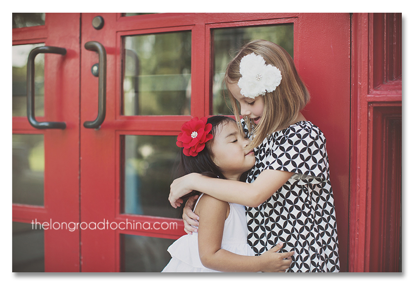 Hugging Sisters Red Glass Doors BLOG