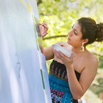 12-024 -- Maya Abboud '16 works on a mural representing Gulick 3 West in a competition on the Eckley Quad.