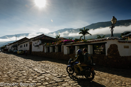 plaza morning travel blue light sun color southamerica architecture clouds square landscape colombia village events transport motorbike nationalmonument townsquare villadeleyva destinations colonialstyle buildingexterior boyacadepartment