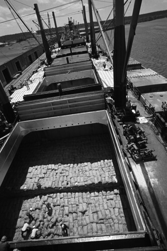 U. S. food is stored in cargo holds on freighters at Lake Charles, Louisiana waiting to be shipped overseas on May 1972. Photo courtesy National Archives and Records Administration.