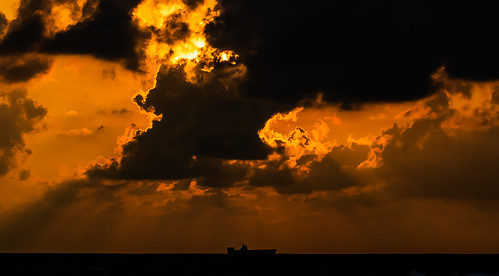 ocean travel sunset sea sky orange cloud beach water boat asia ship srilanka bentota