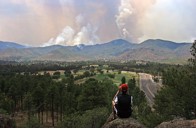 A Los Alamos resident watches the Jemez Mountains burn just a few miles west of town.  Photo by Ethan Frogget.