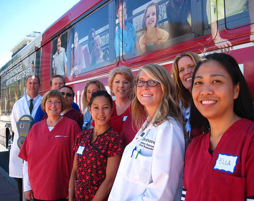Volunteer Nurses in front of the Medicare For All bus