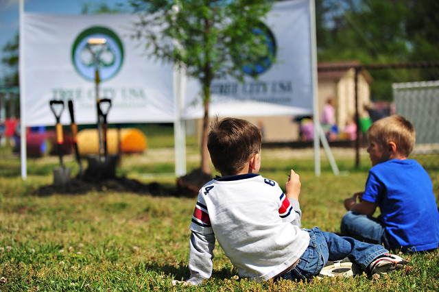 Gabriel Antor, left, and Nickolas Seeger, right, sit and wait for a tree to be planted at the Langley Air Force Base, Va., child development center, April 25, 2012. The tree, which could live hundreds of years if properly cared for, was planted in honor of National Arbor Day. U.S. Air Force photo by Senior Airman Jarad A. Denton/Released.