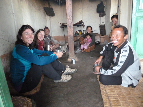 At a village home, we're all enjoying the local tea!