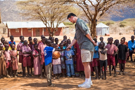August 19th, 2012 - Yao Ming meets a child on a makeshift basketball court in an African village